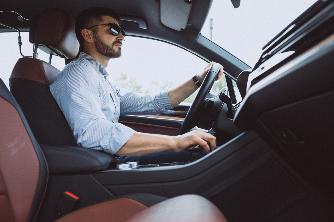 A businessman driving to eork